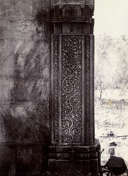 Detail of carved stonework on a pillar of the ruined tomb, Champaner